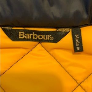 Barbour quilted jacket with detachable hood.
